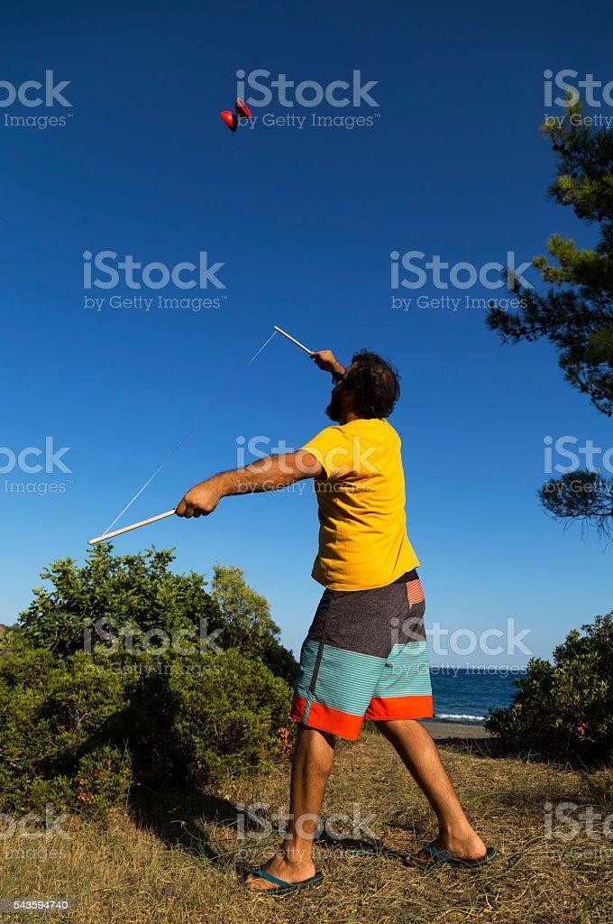 Diabolo Juggler stock photo