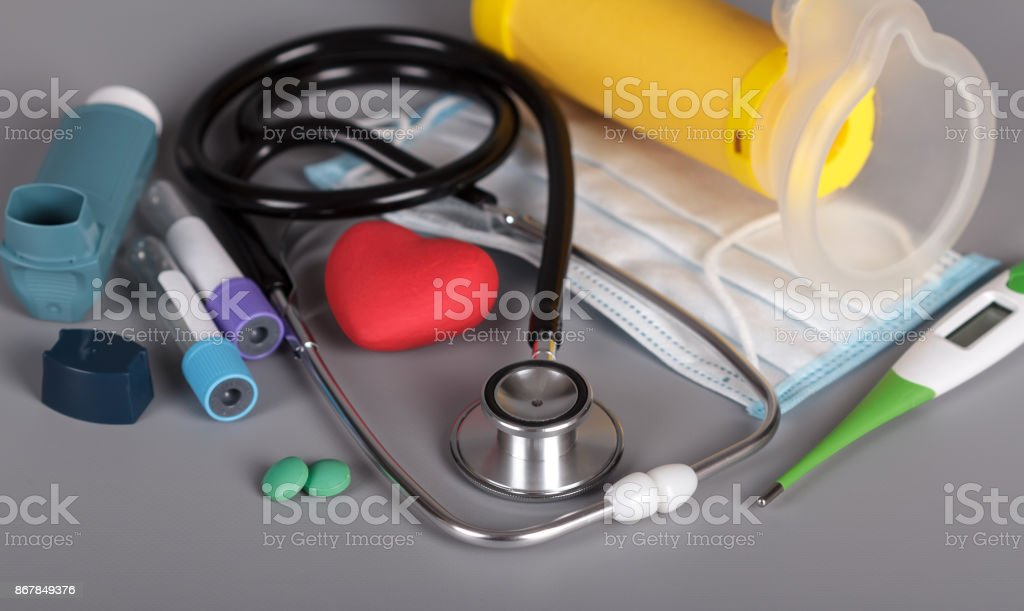 Diagnosis and treatment of bronchial asthma on gray background stock photo