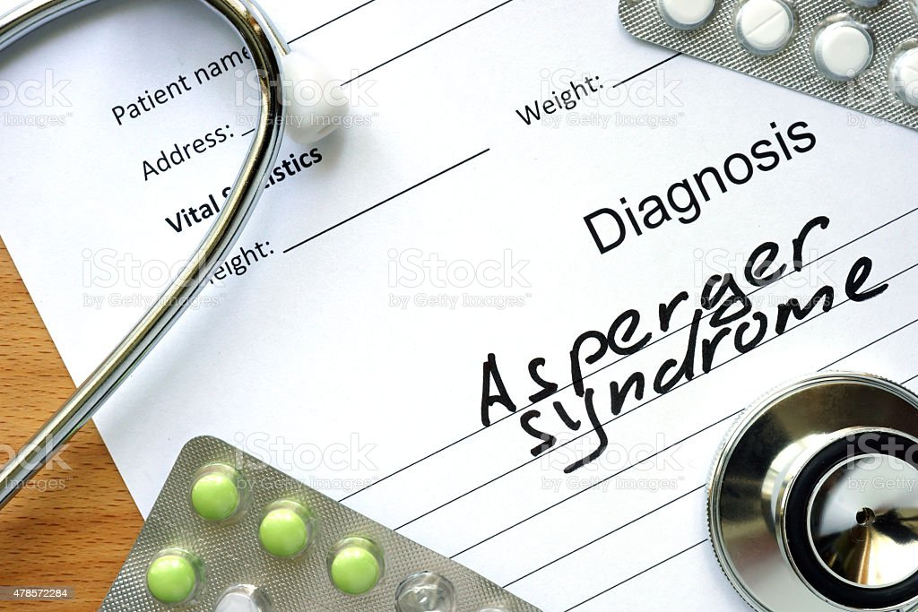 Diagnosis Asperger syndrome and tablets. stock photo