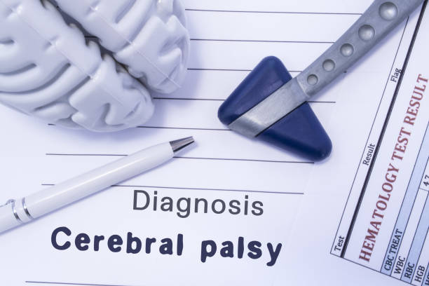Diagnosis Cerebral palsy. Figure brain, neurological hammer, printed on a paper blood test and written diagnosis of Cerebral palsy in  medical form is lying on table in the doctor neurologist cabinet Diagnosis Cerebral palsy. Figure brain, neurological hammer, printed on a paper blood test and written diagnosis of Cerebral palsy in  medical form is lying on table in the doctor neurologist cabinet neuroscience patient stock pictures, royalty-free photos & images