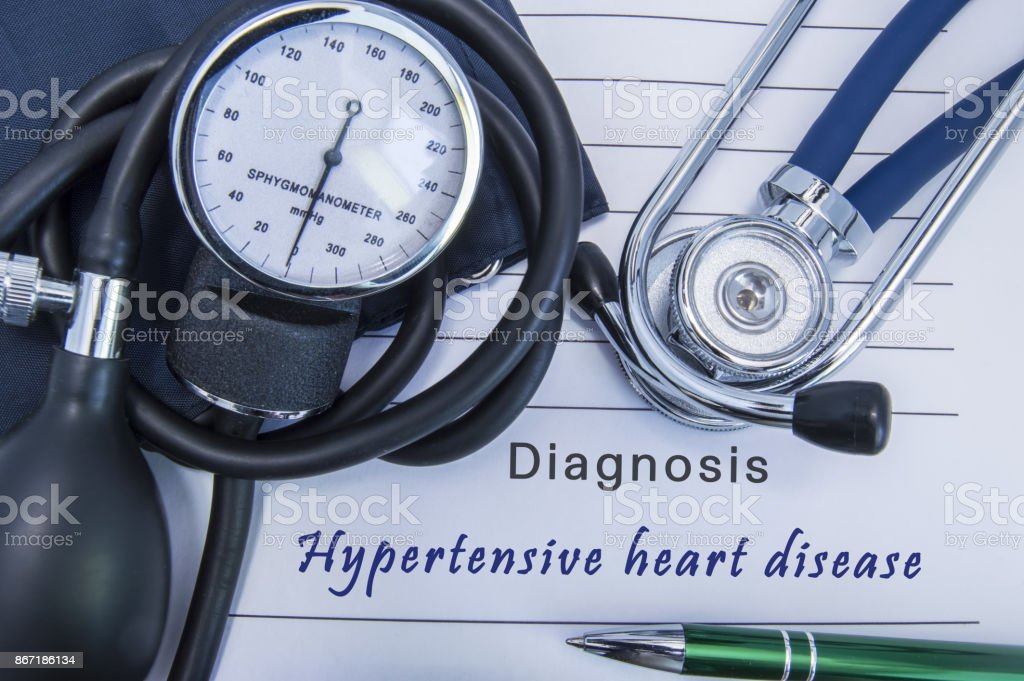 Diagnosis Hypertensive heart disease. A stethoscope, sphygmomanometer with a cuff lie on medical form documentation with diagnosis Hypertensive heart disease in office doctor of internal medicine stock photo