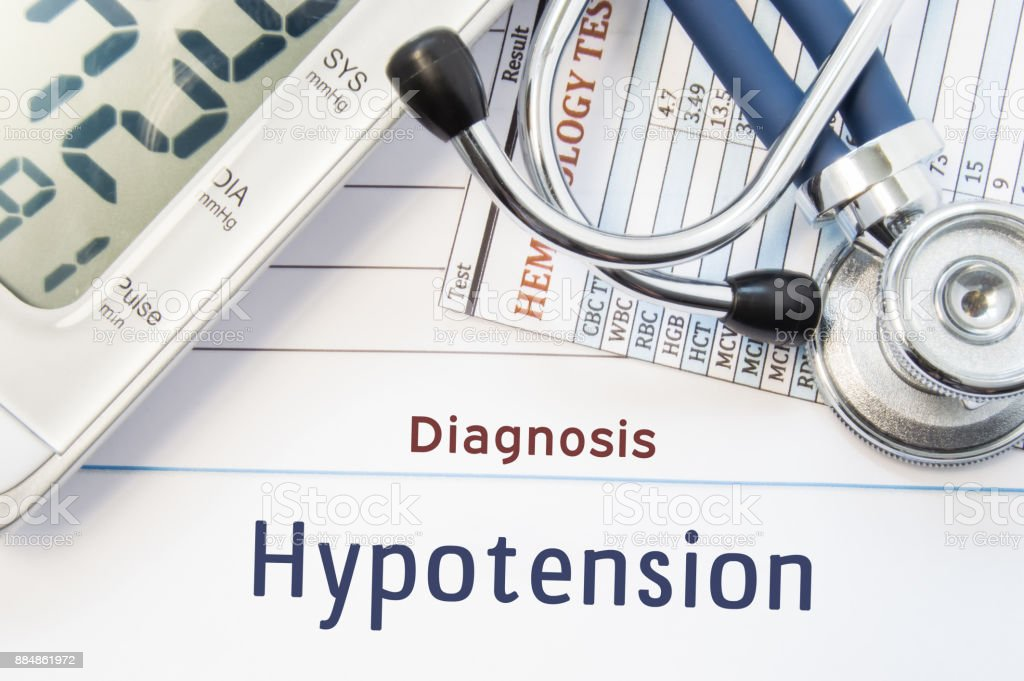 Diagnosis Hypotension. Stethoscope, hematology blood test result and digital tonometer lie on sheet of paper with printed title diagnosis of vascular disease Hypotension stock photo