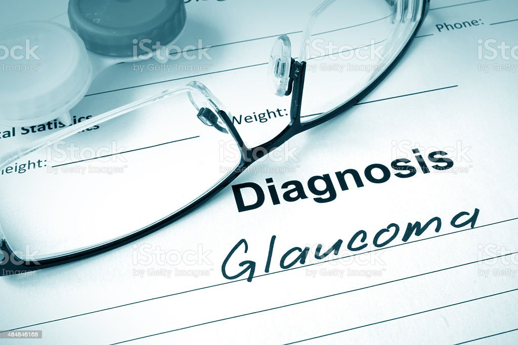 Diagnosis list with Glaucoma and glasses. stock photo