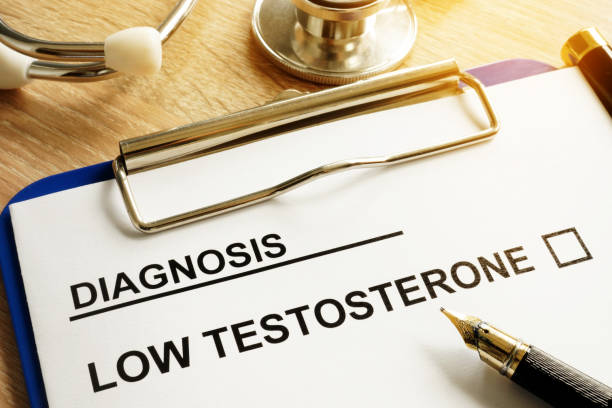 Diagnosis Low testosterone and pen on a desk. stock photo