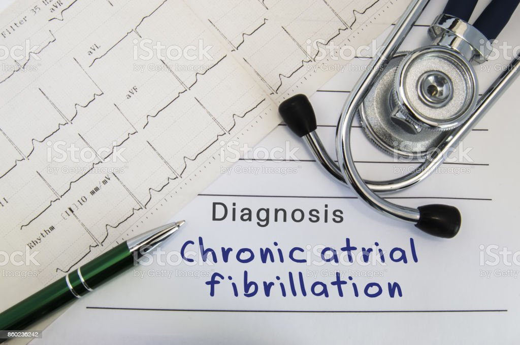 Diagnosis of Chronic atrial fibrillation. Stethoscope, green pen and electrocardiogram lie on medical form with diagnosis of Chronic atrial fibrillation on the desk in the office of cardiologist stock photo
