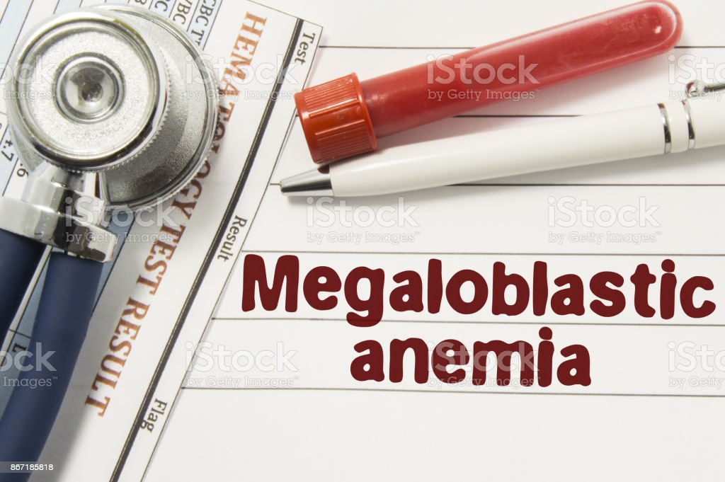 Diagnosis of Megaloblastic Anemia. Test tubes or bottles for blood, stethoscope and laboratory hematology analysis surrounded by text title of diagnosis of Megaloblastic Anemia lie in doctor workplace stock photo