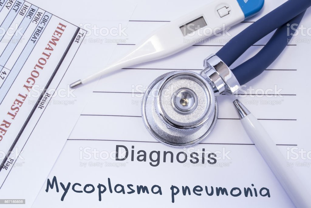Diagnosis of Mycoplasma Pneumonia. Stethoscope, electronic thermometer, blood test results are on medical form, which indicated diagnosis of Mycoplasma pneumonia. Concept for internal medicine stock photo
