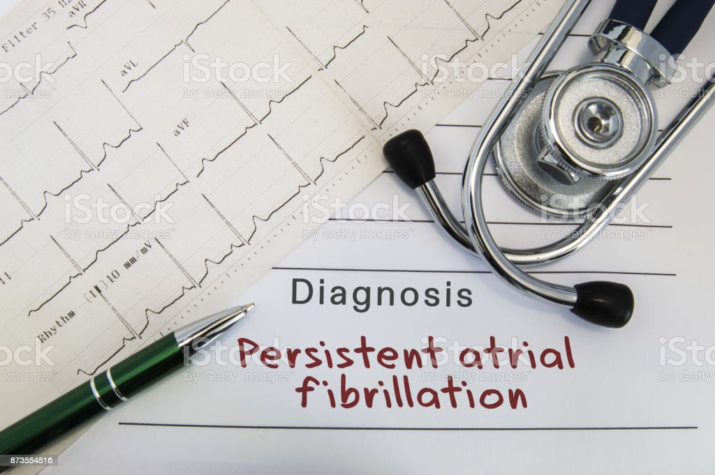 Diagnosis of Persistent atrial fibrillation. Stethoscope, green pen and electrocardiogram lie on medical form with diagnosis of Persistent atrial fibrillation on the desk in the office of cardiologist stock photo