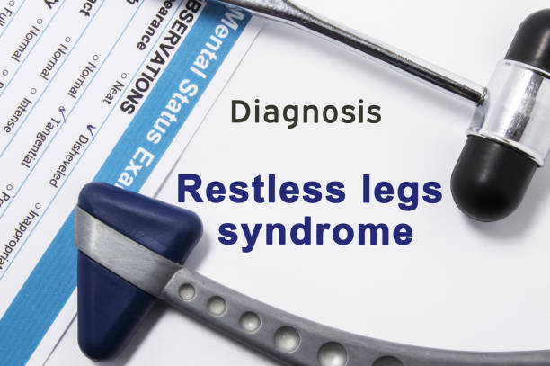 Diagnosis of Restless legs syndrome. Two neurological hammer, result of mental status exam and name of neurologic psychiatric diagnosis Restless legs syndrome on a white background or on doctor table Diagnosis of Restless legs syndrome. Two neurological hammer, result of mental status exam and name of neurologic psychiatric diagnosis Restless legs syndrome on a white background or on doctor table neuroscience patient stock pictures, royalty-free photos & images