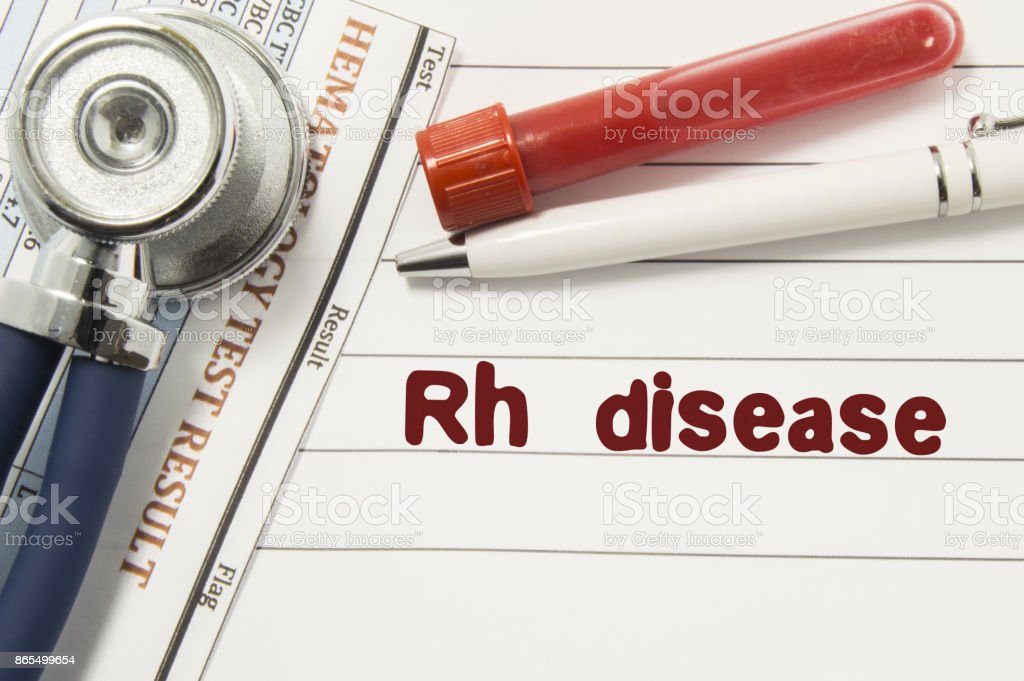 Diagnosis of Rh Disease. Test tubes or bottles for blood, stethoscope and laboratory hematology analysis surrounded by text title of diagnosis of Rh Disease lie in the doctor workplace stock photo