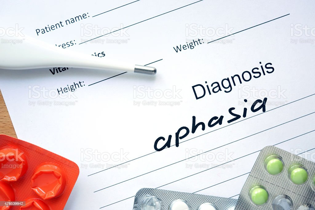 Diagnostic form with diagnosis Aphasia and pills. stock photo