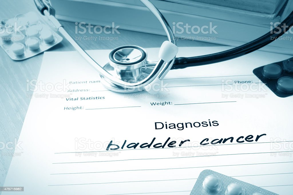 Diagnostic form with diagnosis bladder cancer and pills. stock photo