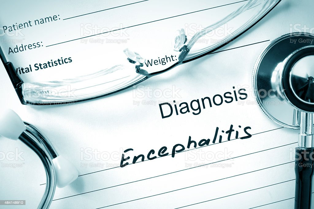 Diagnostic form with diagnosis Encephalitis and pills. stock photo