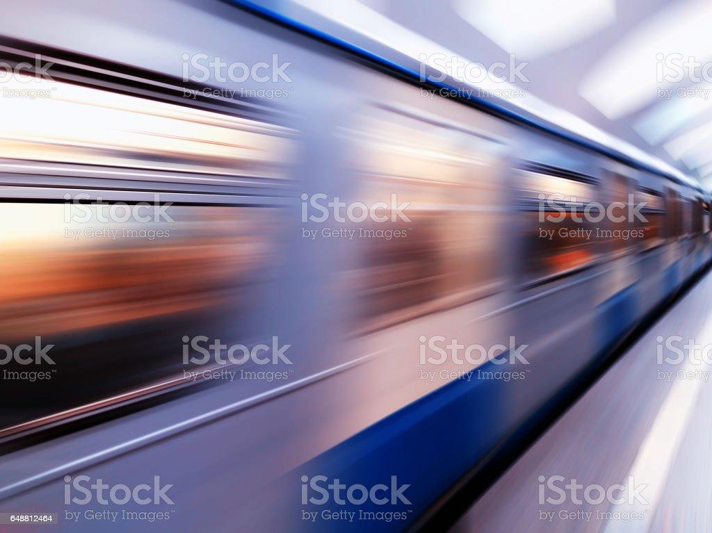 Diagonal blue motion blur metro train background stock photo