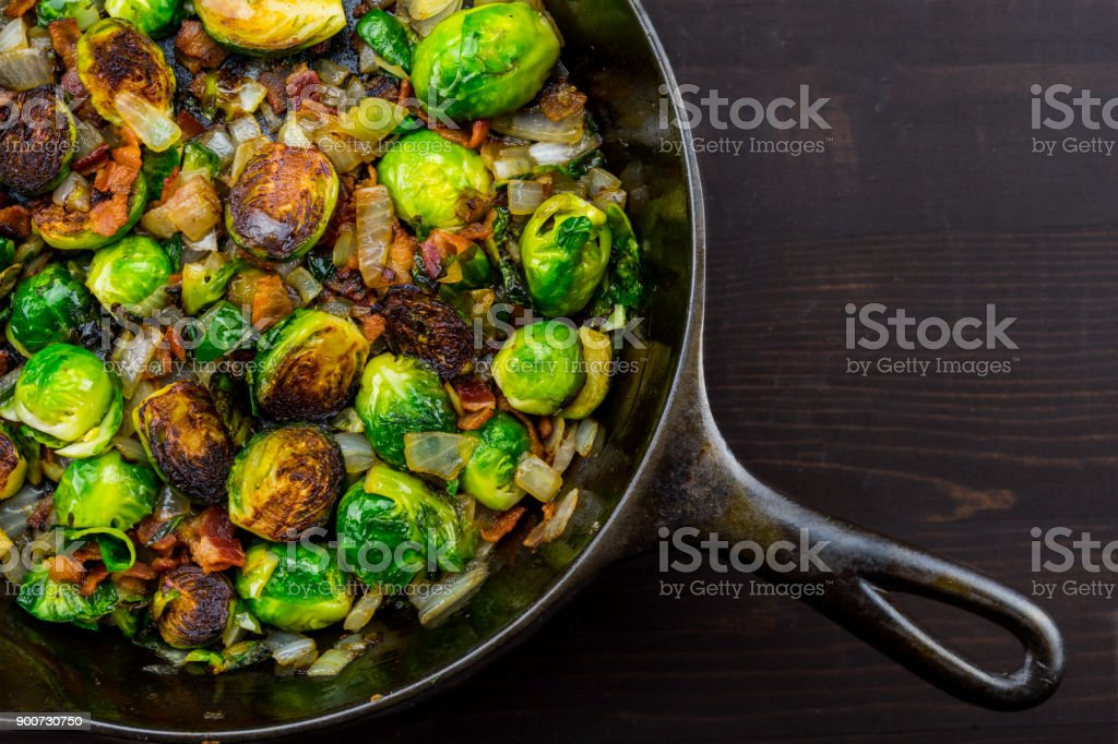 Diagonal Cast Iron Skillet with Brussels Sprouts stock photo