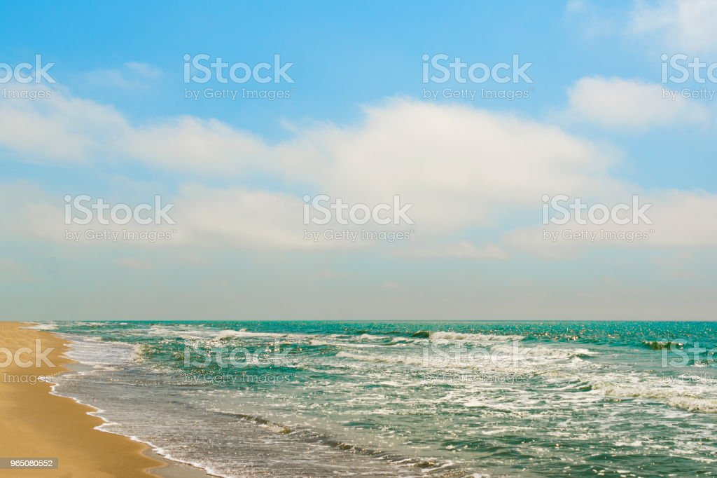 Diagonal composition of sand beach shore with the blue sea zbiór zdjęć royalty-free