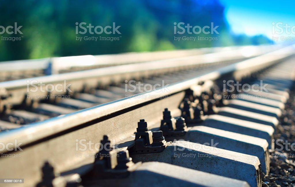 Diagonal countryside railway bokeh background stock photo