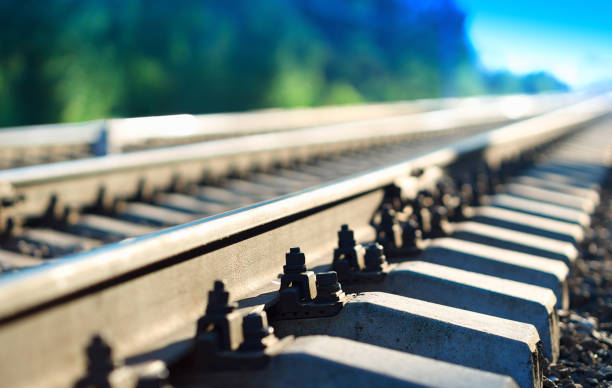 Diagonal countryside railway bokeh background Diagonal countryside railway bokeh background tramway stock pictures, royalty-free photos & images