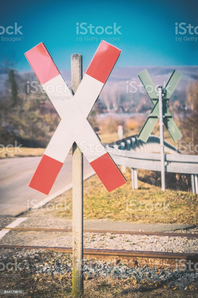Diagonal cross sign in front of rails stock photo
