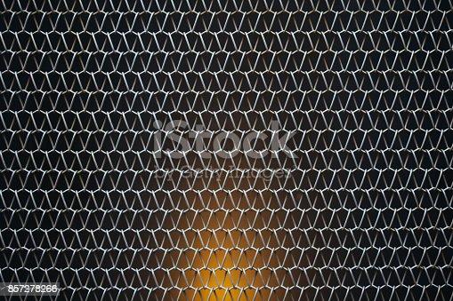 Diagonal Metallic mesh grid net fence texture background