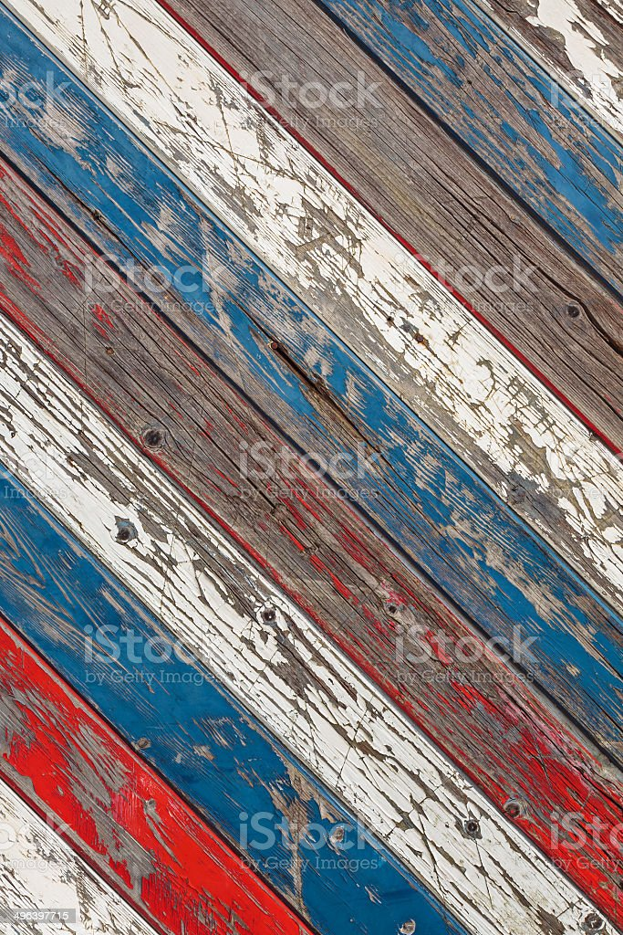 Diagonal old planks painted white, red and blue stock photo