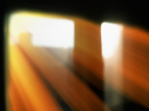 Diagonal rays of light from windows bokeh background stock photo
