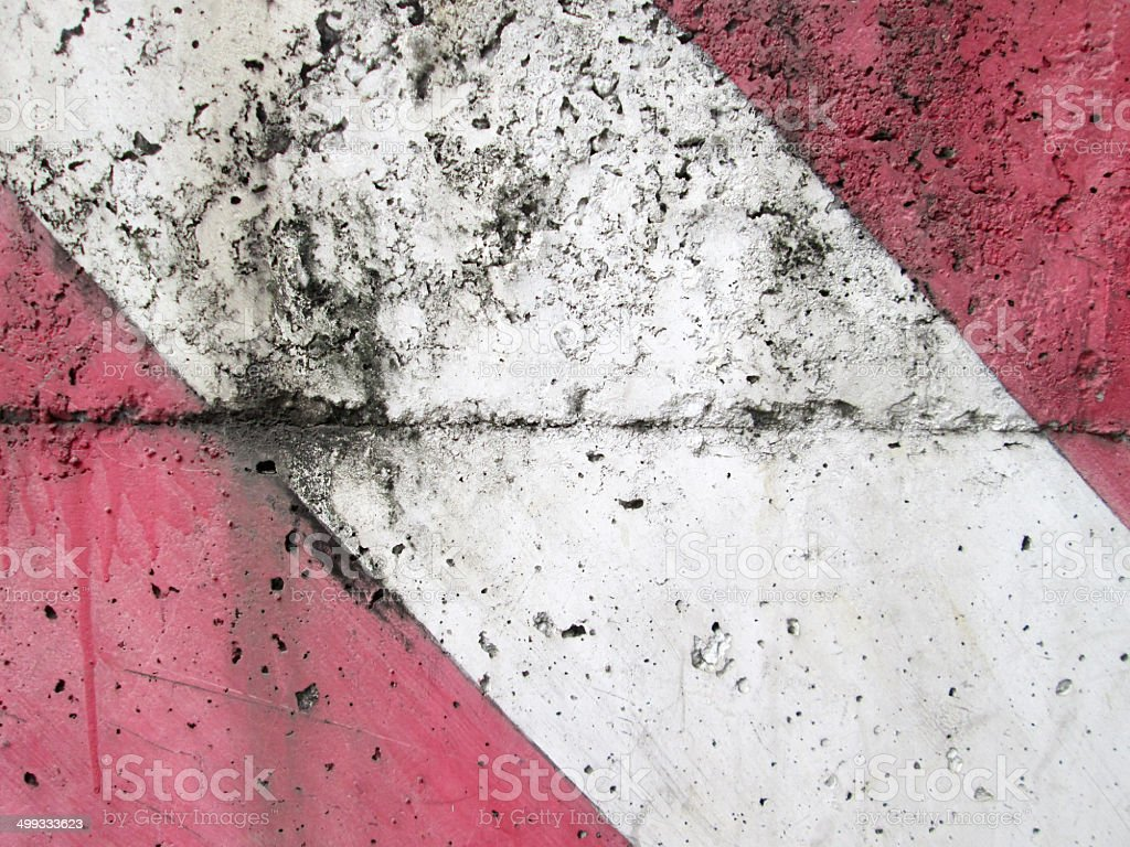 Diagonal Redwhite Paint Pattern On A Rough Textured Cement Stock