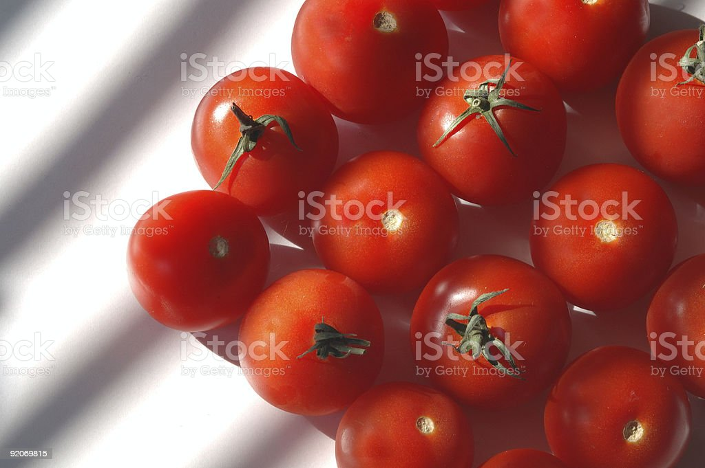 Diagonal rows of fresh red ripe tomatoes royalty-free stock photo