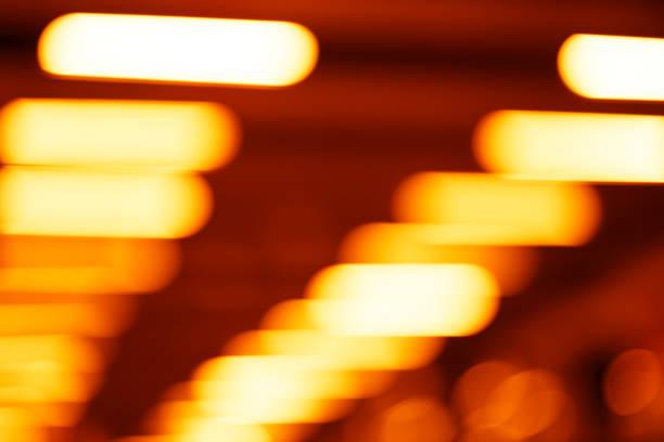 Diagonal warm orange office lamps bokeh background stock photo