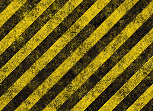 Diagonal yellow and black hazard stripes stock photo