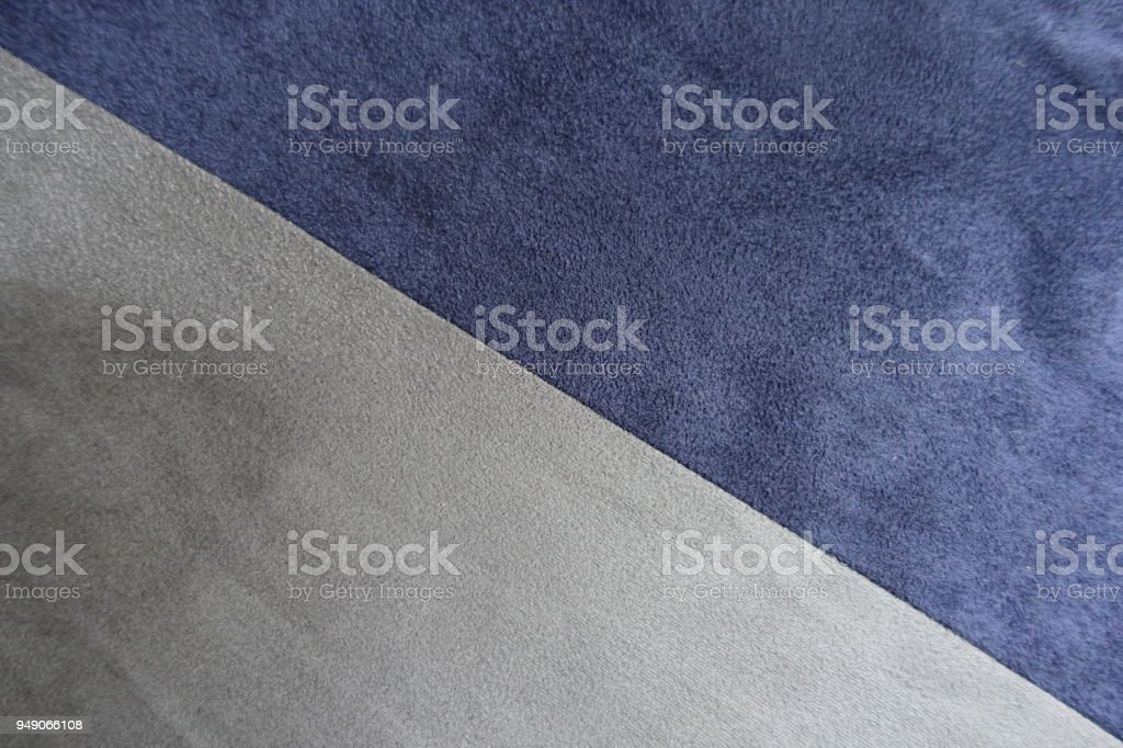 Diagonally sewn blue and grey artificial suede from above stock photo