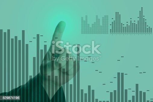 611747524istockphoto Diagrams and charts on touch screen 529874195