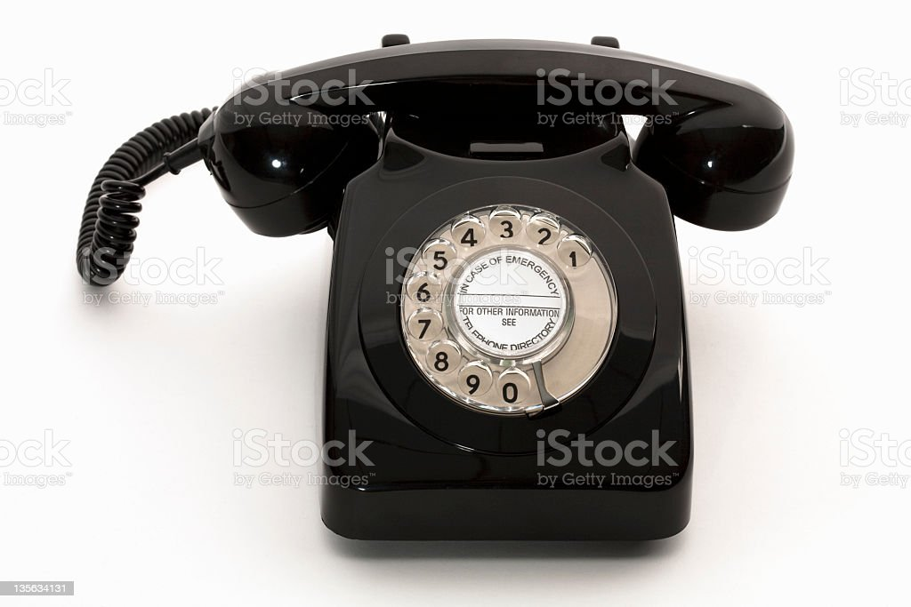 Dial area on vintage rotary black telephone stock photo