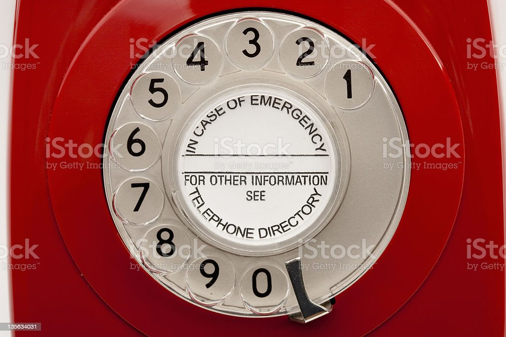 Dial area on vintage rotary red telephone stock photo