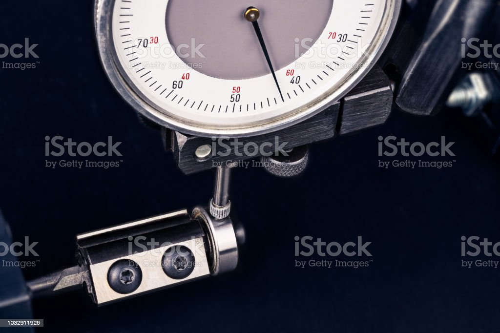 Dial gauge indicator when measuring endmill with ball bearing stock photo
