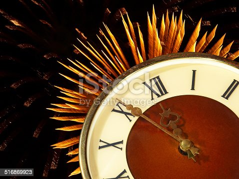 istock Dial of hours on a golden firework background.Eve of new year. 516869923