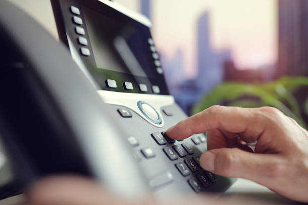 Dialing a telephone in the office Dialing telephone keypad concept for communication, contact us and customer service support dial stock pictures, royalty-free photos & images
