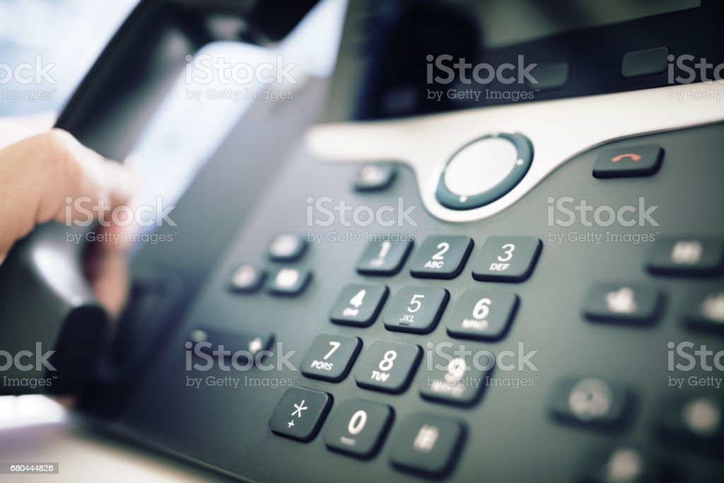 Dialing a telephone in the office stock photo