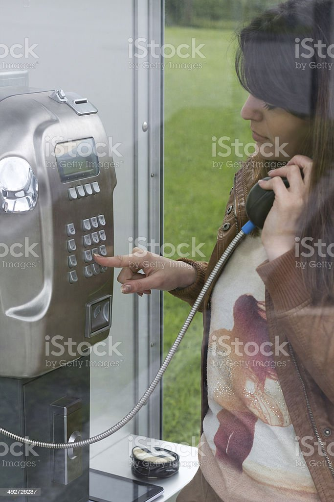 Dialing in the Telephone Booth stock photo
