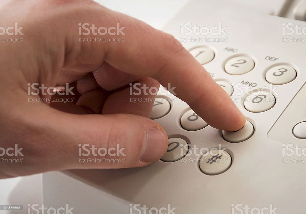 Dialing nine stock photo