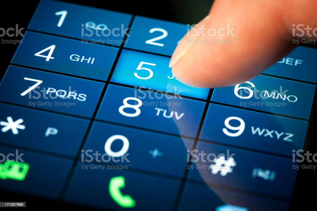 Dialing number on a touch-screen in blue stock photo