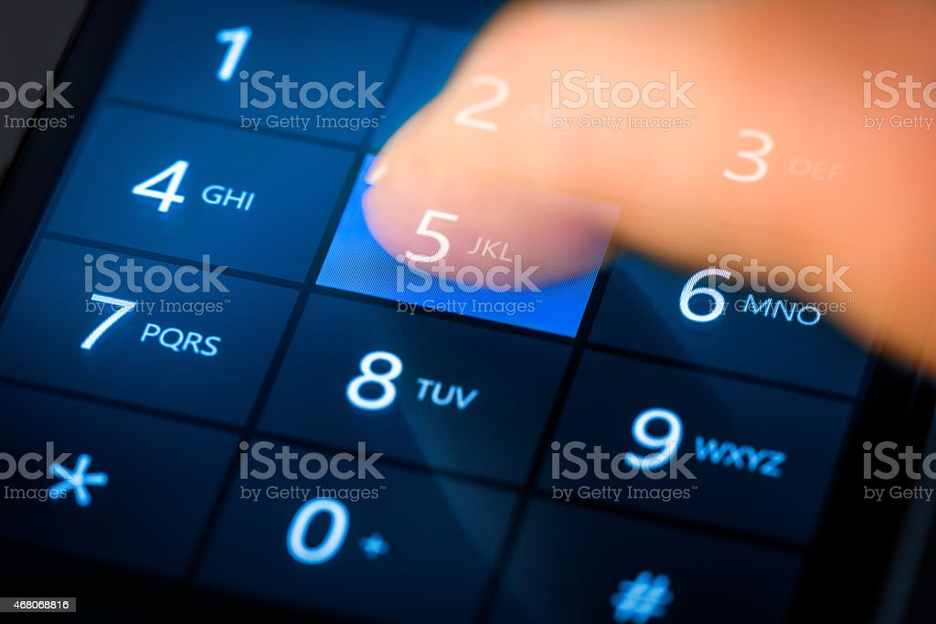 Dialing on blue touchscreen smart phone. stock photo