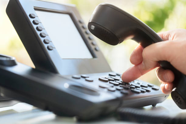 Dialing telephone keypad in office Dialing telephone keypad concept for communication, contact us and customer service support conference phone stock pictures, royalty-free photos & images