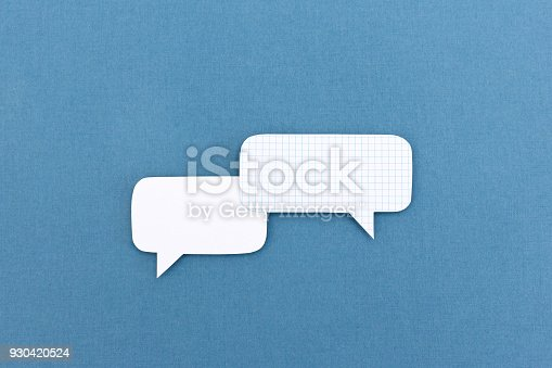 istock Dialog - two blank white speech bubbles 930420524