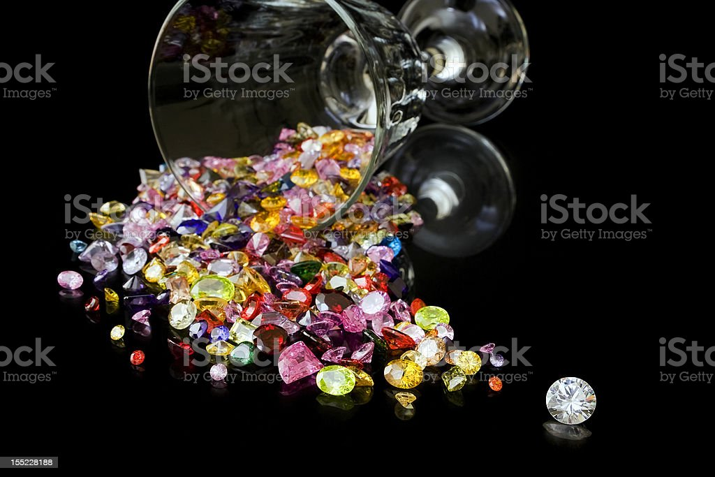 Diamond And Gems From Wine Glass stock photo