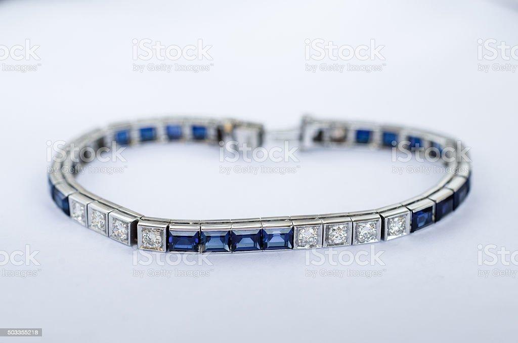 Diamond and sapphire bracelet in 14k white gold stock photo