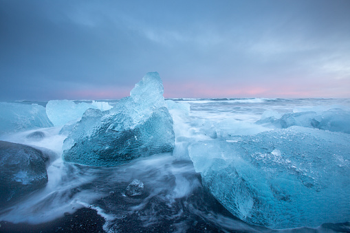 Spectacular Image of large pieces of Ice washed up on beach known as Diamond Beach, or Jokulsarlon, Iceland