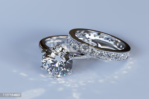 White gold solitaire diamond engagement ring and eternity wedding band with round brilliant cut diamonds, channel setting