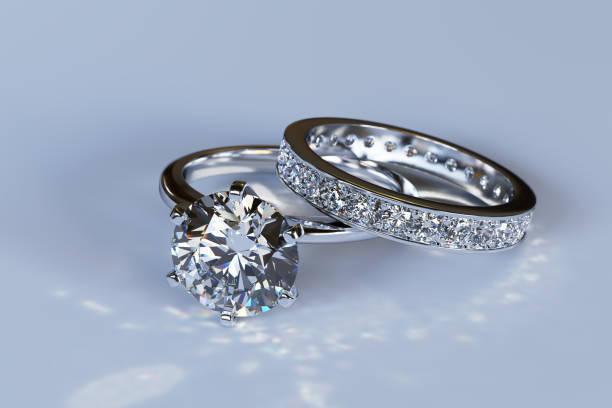 diamant förlovningsring, vigselring på blå blank bakgrund - förlovningsring bildbanksfoton och bilder