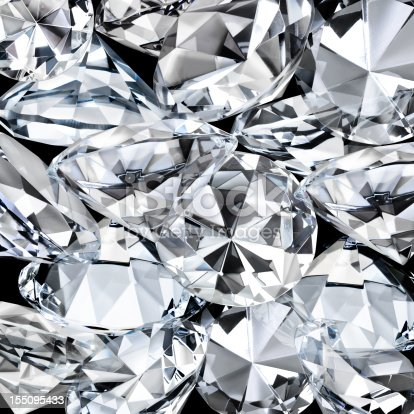 Closeup of a cluster of diamonds over black - good for background use